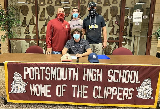 Myles Sargent, front, signs his National Letter of Intent last Friday to play Division I college baseball at the University of Maine. Pictured in back, from left, Portsmouth High School head baseball coach Tim Hopley, and Tommy Lawrence and Mike Montville from Powerhouse Sports.