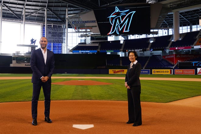 New Marlins General Manager Kim Ng (right) stands with CEO Derek Jeter at Marlins Park on Monday during her virtual introductory news conference. Photo provided by Miami Marlins