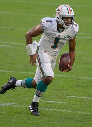 Dolphins rookie quarterback Tua Tagovailoa runs against the Chargers on Sunday.