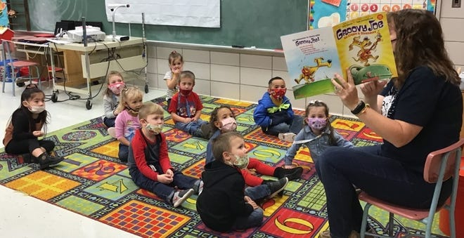 Macksville City Library director Jodi Suiter reads a special story to Macksville area preschoolers for a special event Wednesday at the Macksville Grade School.