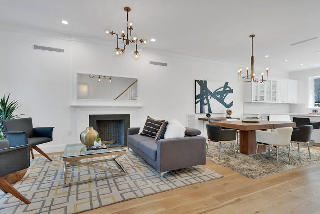 Silver and gold add rhythm and interest in this living/dining space.