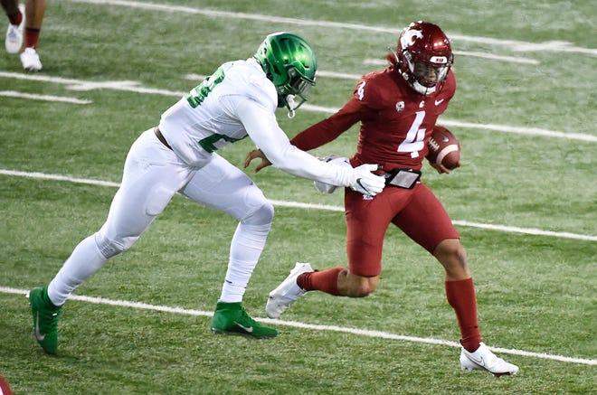 Oregon linebacker Adrian Jackson stops Washington State quarterback Jayden de Laura for a short gain during the second quarter of Saturday's game in Pullman, Wash.