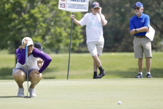 Pro golfer Julie Inkster studies the ball on the 13th hole during the Rockford Pro-Am on July 8, 2019, at Aldeen Golf Club in Rockford.