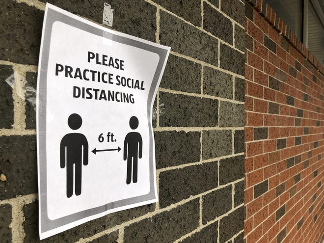 A sign encouraging social distancing is posted on Aldi's grocery store in Belvidere on March 26, 2020, during the onset of the coronavirus pandemic.