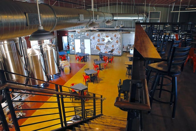Pig Minds 9,000-square-foot expansion includes a second-floor mezzanine for private parties.