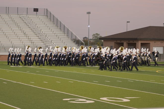 The Stephenville High School Yellow Jacket band takes the field for competition on Saturday in Mineral Wells.