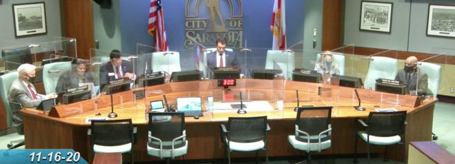 Sarasota Mayor Hagen Brody and Vice Mayor Erik Arroyo broke the city's own rules for wearing masks in Sarasota's City Commission chambers on Monday, just a week after one of their own tested positive for COVID-19.