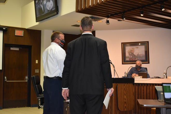 Shawnee City Manager Chance Allison, right, presents his choice for Shawnee Fire Chief, SFD Battalion Chief Tony Wittmann, before City Commissioners Monday.