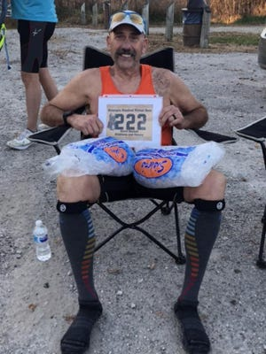 Ultramarathoner Dave Benson, 62, of Galva ices his legs after completing the Hennepin Hundred, a 100-mile run, in Colona. [Submitted by Dave Benson]