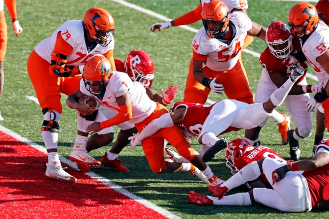 Illinois quarterback Isaiah Williams (1) scores a touchdown during the first half of an NCAA college football game against Rutgers on Saturday, Nov. 14, 2020, in Piscataway, N.J. (AP Photo/Adam Hunger)