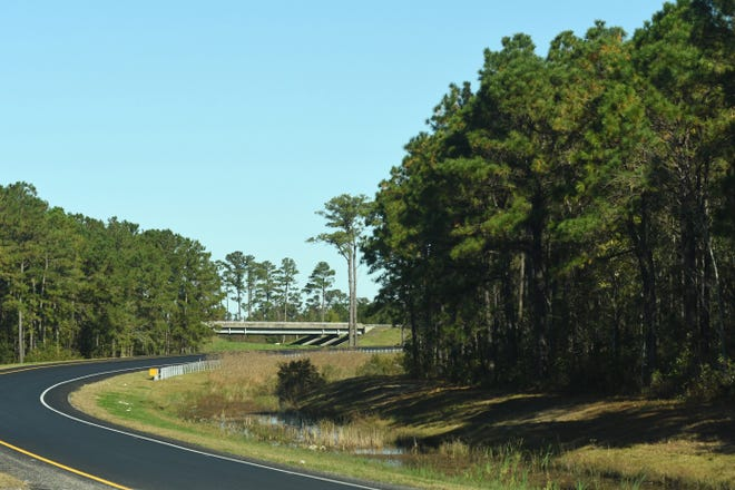 Traffic travels along the I-40 and I-140 exit ramps Monday Nov. 16, 2020. The New Hanover Board of Commissioners consider two zoning requests which make up over 500 acres of land just off both ramps.
