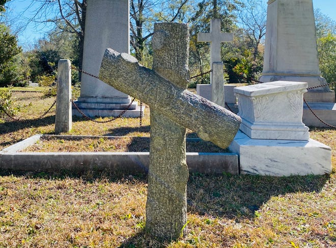 The stone cross marker that stands at the center of the Martin family plot at Oakdale Cemetery in Wilmington marks the final resting place of Nancy Martin, the girl supposedly buried in a barrel of alcohol.