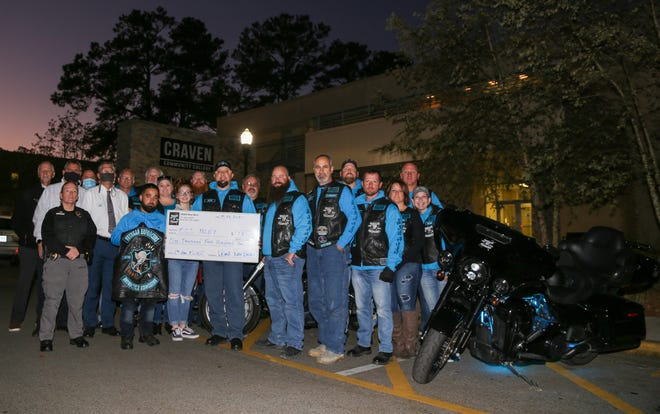 The Veteran Enforcers Motorcycle Association (VEMA) of New Bern presented a $1,500 check to the Craven CC Foundation on Nov. 16 for the Fallen Officer Memorial Scholarship to benefit students in the college's Basic Law Enforcement Training program. The VEMA contributions are made in honor and memory of fallen officers who served the Craven County community in uniform with commitment and passion to ensure public safety. VEMA established the scholarship six years ago to memorialize New Bern police officer Alexander Thalmann, who was shot and killed in the line of duty at age 22 on March 31, 2014. [CONTRIBUTED PHOTO]