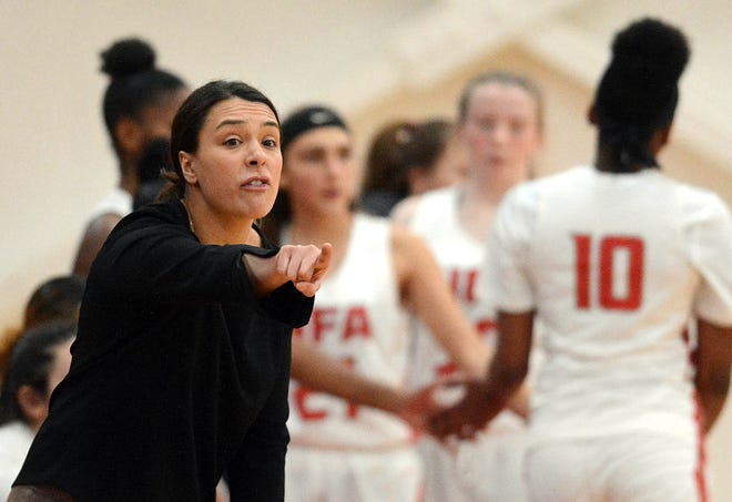 NFA girls basketball coach Courtney Gomez directs her team against Mercy in Norwich.  The CIAC announced on Tuesday that the winter sports season will be postponed to Jan. 19.