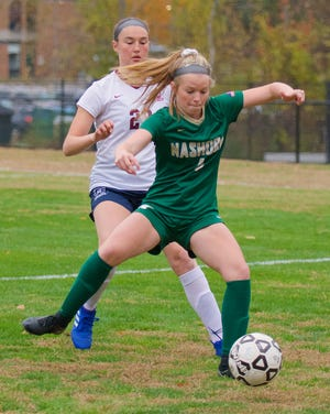 Nashoba's Morgan Diefenbach protects the ball during a game last season.