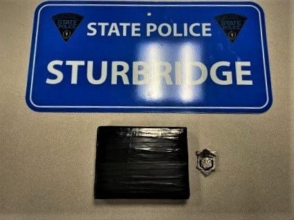 A Lawrence man is facing charges after state police said they found 1,100 grams of heroin in his trunk in Sturbridge on Sunday.