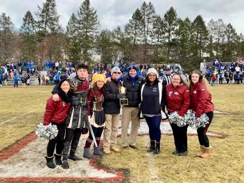 Students join Fitchburg High School Principal Jeremy Roche, center left, and Leominster High School Principal Steve Dubzinski. center, in the presentation of the Turkey Day Canned Food Drive Challenge trophy after the 2019 game at Crocker Field.