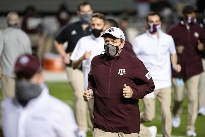 Texas A&M coach Jimbo Fisher runs off the field before the team's NCAA college football game against South Carolina earlier this season.