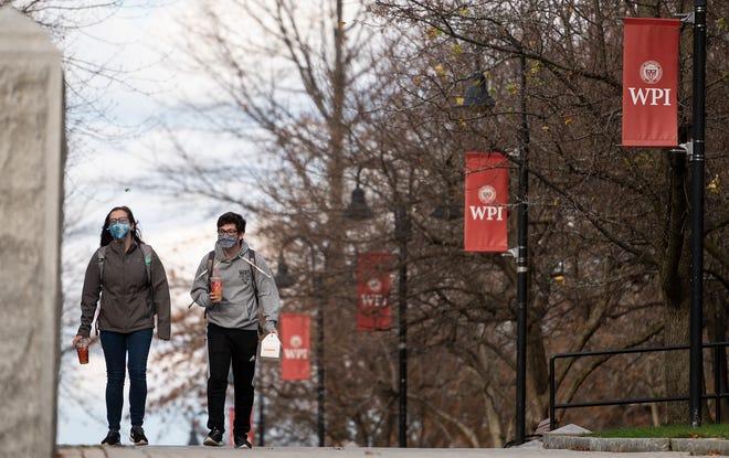 WPI students walk through campus Tuesday.