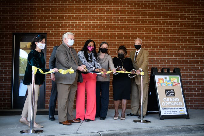 FTCC President J. Larry Keen, second from left, and other dignitaries cut the ribbon for the grand opening of the food pantry at Fayetteville Technical Community College on Tuesday.