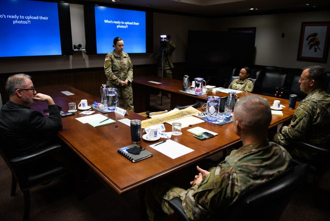 Sgt. 1st Class Ashely Savage pitches her idea at the 18th Airborne Corps' Dragon's Lair Innovation Challenge on Tuesday. Savage proposed the corps implement a central website or mobile application to store photos from soldiers, veterans, and family members for historical documentation.