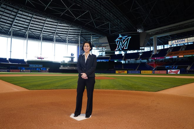 In this photo provided by the Miami Marlins, new Miami Marlins general manager Kim Ng poses for a photo at Marlins Park stadium before being introduced during a virtual news conference last Monday in Miami. Ng discussed her climb to become the first female GM in the four major North American professional sports leagues. [Joseph Guzy/Miami Marlins via AP]