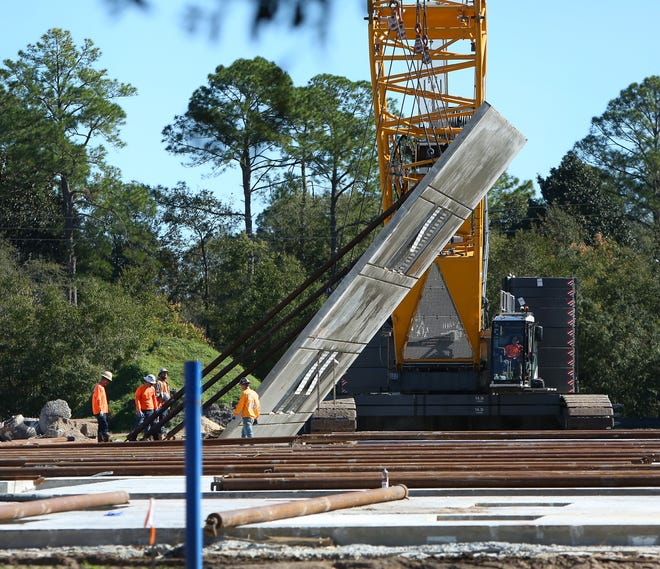 A construction crew tilts up a wall Nov. 17 as part of renovations at Metcalfe Elementary School, where a Gainesville For All early learning center is proposed to be located.