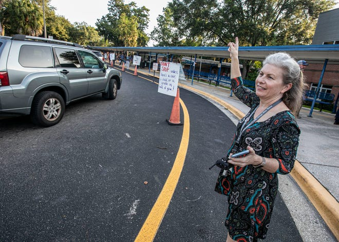 Principal Carrie Geiger directs traffic during the first day of classes at PK Yonge in this Aug. 12, 2019 file photo.