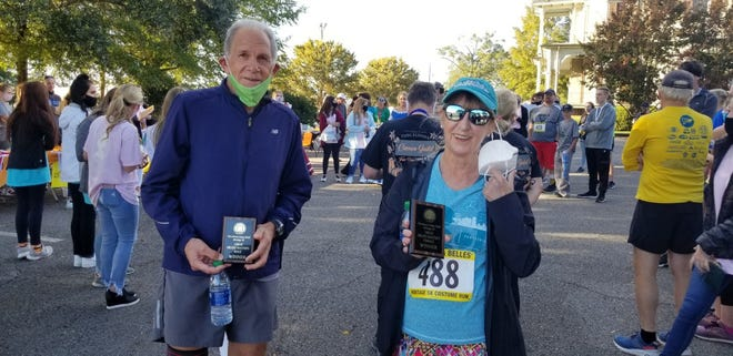 Gadsden's Dave Micale, left, and Albertville's Cindy Duke hold their Great Grand Master awards after the Cameo Guild Heritage 5K race in Tuscaloosa on Sunday.