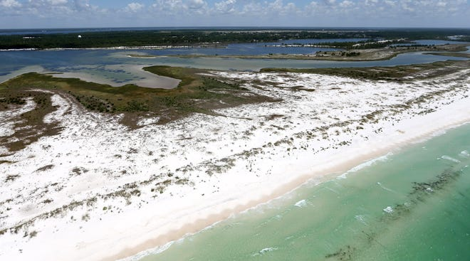 The area that was once East Pass is filled with sand on July 28, 2016, at Shell Island.