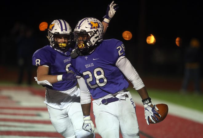 DeSales' Quintell Quinn (28) celebrates with Nathan Barber after scoring a touchdown against Kettering Alter in a Division III state semifinal Nov. 13 at London. The Stallions won 23-13 and advanced to play Chardon in the state final Saturday, Nov. 21, at Massillon Paul Brown Tiger Stadium.