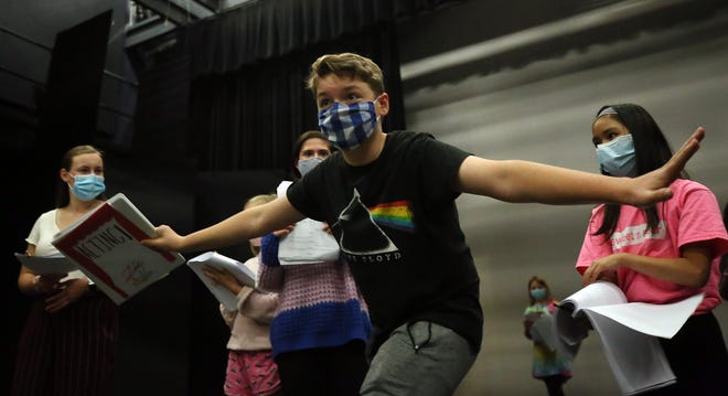 "Luke Allen, 13, with the Abbey Theater of Dublin portrays Trivia during a rehearsal for a scene in the troupe's performance of ""Land of Forgotten Toys: A Christmas Musical"" on Nov. 10. The show will be a streamed performance from Dec. 18 to 27."