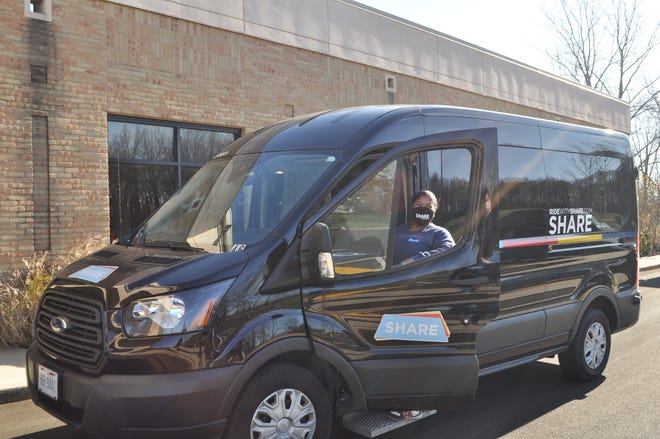 Dalandrea Whiteside, operations supervisor for SHARE Mobility, drives one of the vehicles in the organization's fleet outside the Phyllis A. Ernst Senior Center in Hilliard. Hilliard is using CARES Act money for a pilot program with SHARE Mobility.