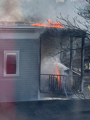 Fire erupts from the rear porches, the site of the initial flames, of 171 Columbia St. Tuesday morning, Nov. 17.