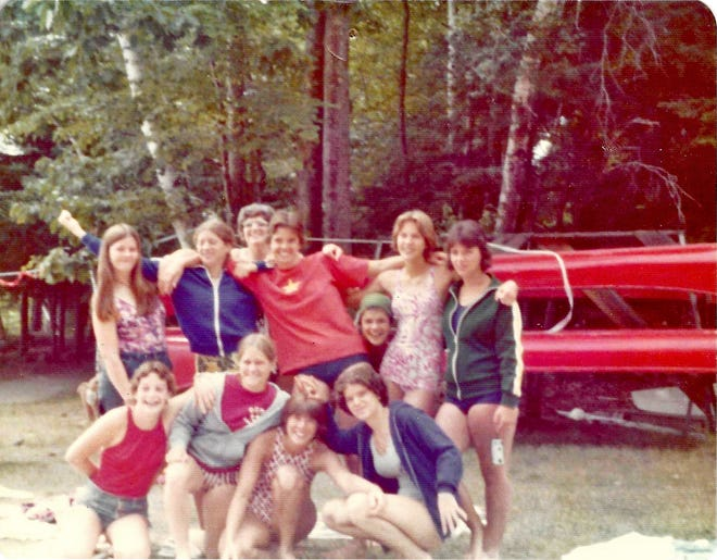 Marblehead resident Julie Newburg poses for a photo with her camp friends in 1975.