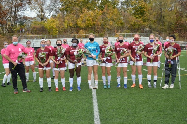 Arlington girls varsity soccer seniors, from left, with Coach Paul Austin: Sophia Saleh, Erin Walsh, Njuere Ewah, Claire Ewen, Michelle Mahoney, Riley McKenna, Caleigh Lyons, Sophie Routenberg, Maia Patel-Masini.