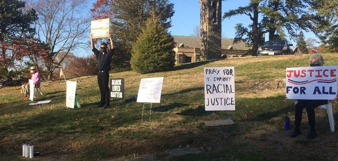 A vigil for racial justice is held at St. Andrew's in Marblehead.