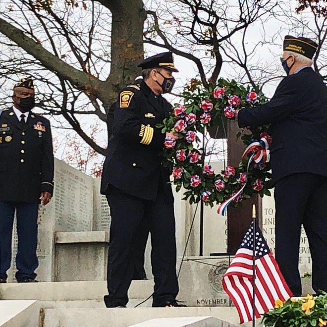 Brookline's Acting Chief of Police Mark Morgan, an army veteran, helped place the wreath at the town's 2020 Veterans Day ceremony.