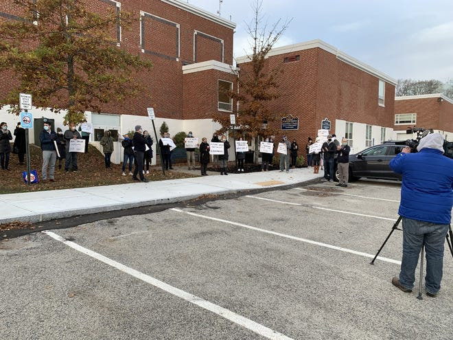 The Cohasset Teachers Association gathered Tuesday, Nov. 17 outside Superintendent Patrick Sullivan's office to protest the district's plans to increase in-person learning.