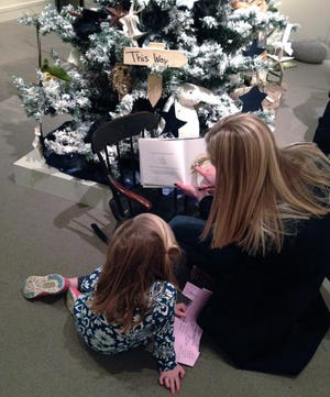 A mother and child reading at the Annual Family Trees event at the Concord Museum.
