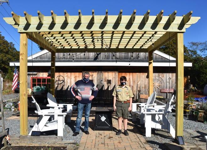 Christopher Hart and John Machado under the completed pergola at Three Harts Farm.