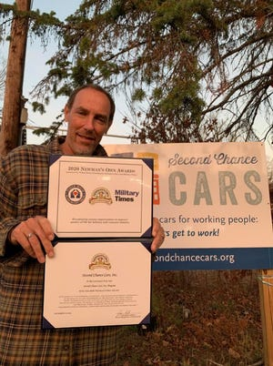 Dan Holin, executive director of Second Chance Cars, with the award from Newman's Own Foundation.