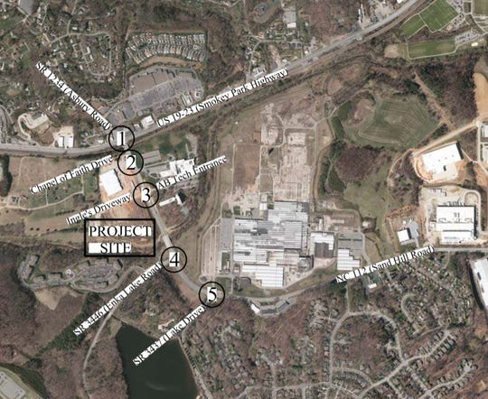 Plans call for a 148-room hotel, 180 multi-family condominiums and retail space on a 27-acre site in Enka off Sand Hill Road near Smokey Park Highway.