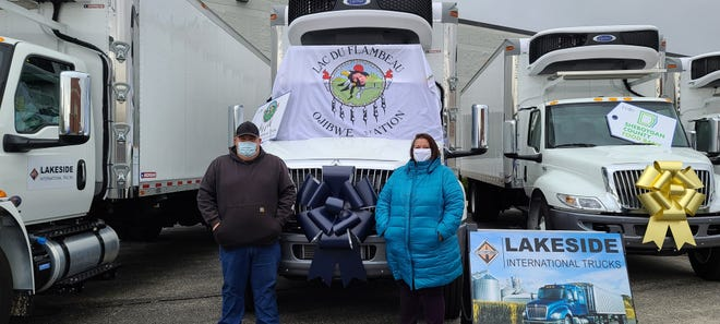 Organizers for the Lac du Flambeau Ojibwe Tribe's food distribution system pose for a photo.