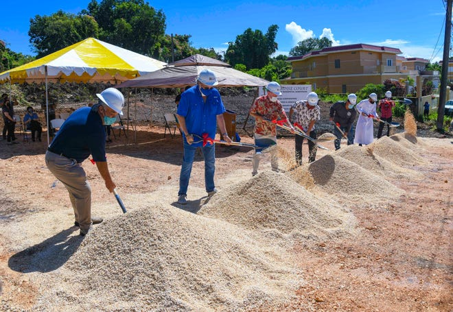 TRI, Inc. personnel and project principals, overturn shovelful of gravel during a ceremonial groundbreaking celebrated to kick off the Paradise Court housing project in Mangilao on Tuesday, Nov. 17, 2020. The proposed $4M subdivision project is slated to consist of the construction of 16 three-bedroom, two-bath single-family homes and one four-bedroom, three-bath home within the gated community, to be built along the Old Price Road in Mangilao.