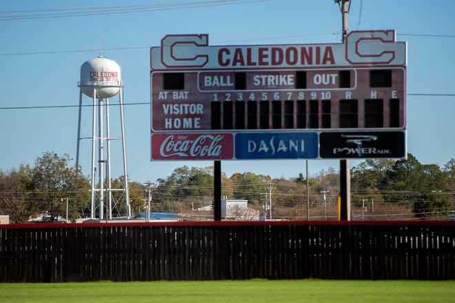 """Most signs of the Confederates as the Caledonia, Miss., high school nickname have been removed from school grounds, but on Monday, Nov. 16, 2020, beyond the scoreboard on the baseball field at Caledonia High stands the town water tower still reading, """"CALEDONIA HOME OF THE FEDS"""". As of mid-November, Caledonia High has changed its nickname from Confederates to the Cavaliers."""