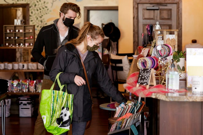 Customers shop inside Retail Therapy, 1005 Main St., Tuesday, Nov. 17, 2020 in Lafayette.