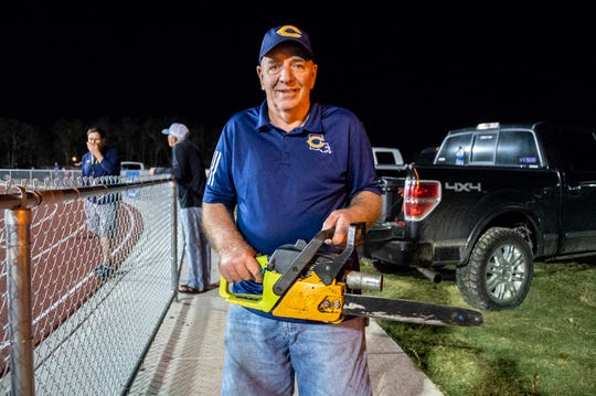 Willy Domnigue started the tradition at Carencro High of the football players running in with a chainsaw.