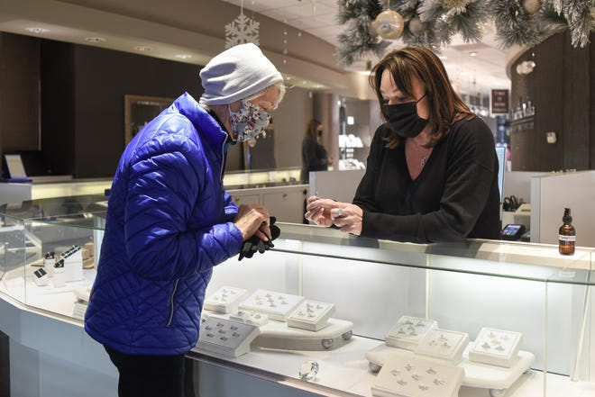 Becky Beauchine Kulka, right, of Becky Beauchine Kulka Diamonds and Fine Jewelry in Meridian Township chats with Lynn Bartley of East Lansing about a ring Bartley is dropping off to be cleaned, Tuesday, Nov. 17, 2020.