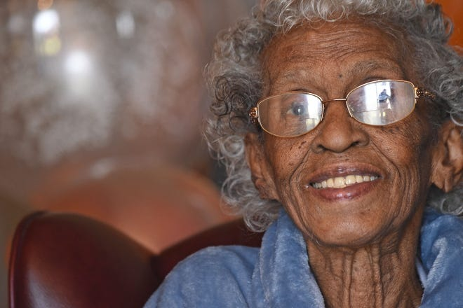 Anna Evans smiles for the camera as she celebrated her 100th birthday on Tuesday.